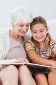 Little girl reading with granny — Stock Photo