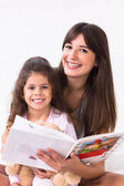 Mother and daughter reading storybook — Stock Photo