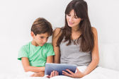 Mother and son using tablet pc — Stock Photo