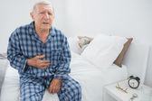 Old man suffering with body pain — Stock Photo