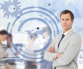 Salesman with arms crossed with a blue world map illustration — Stock Photo