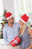 Smiling couple at christmas — Stock Photo