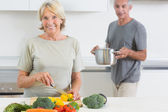 Husband bringing a pan to his wife — Stock Photo