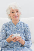 Elderly cheerful woman looking at camera — Stock Photo