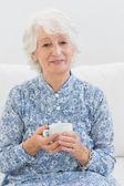 Elderly cheerful woman looking at camera — Stock Photo