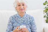 Elderly smiling woman looking at camera — Stock Photo