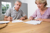 Couple signing documents together — Stock Photo