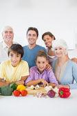 Multi generation family smiling in kitchen — Stock Photo