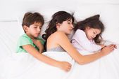 Mother asleep with her children — Stock Photo