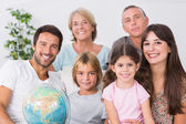 Cheerful family sitting on couch — Stock Photo