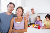 Mother and father standing by kitchen counter — Stock Photo