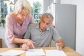 Wife showing where to sign to her husband — Stock Photo