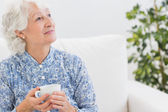 Elderly smiling woman looking away — Stock Photo