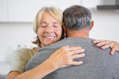 Joyful couple embracing — Stock Photo