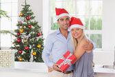 Happy couple at christmas — Stock Photo