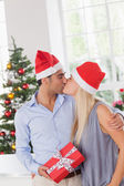 Kissing couple at christmas — Stock Photo