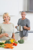 Husband bringing a pan to his smiling wife — Stock Photo