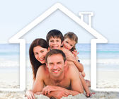 Family on the beach with a white house illustration — Stock Photo