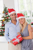 Attractive couple at christmas — Stock Photo