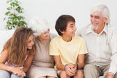 Grandparents with grandchildren chatting — Stock Photo