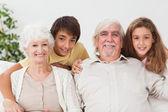 Grandparents with grandchildren portrait — Stock Photo