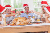 Siblings pulling a christmas cracker — Stock Photo