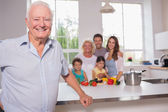 Grandfather in front of his family — Stock Photo