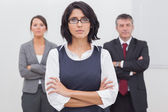 Three business folding their arms seriously — Stock Photo