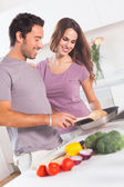 Couple preparing food at the stove — Stock Photo
