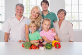 Family smiling with vegetables — Stock Photo