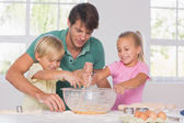 Children mixing the dough — Stock Photo
