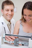 Medical scale being adjusted — Stock Photo