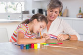 Child drawing with her grandmother — Stock Photo