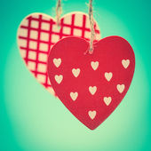 Two hanging heart ornaments — Stock Photo