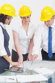 Architects looking at plan — Stock Photo