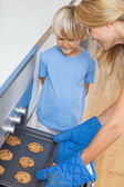 Mother and her son baking cookies — Stock Photo