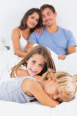 Sister and brother lying on the bed — Stock Photo