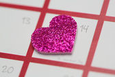 Close up of pink glittery heart marking valentines day — Stock Photo