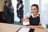 Happy woman handing you a name tag — Stock Photo