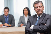 Serious businessman with arms crossed — Stock Photo