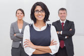 Three businesspeople folding their arms — Stock Photo