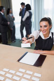 Woman handing you a name tag — Stock Photo