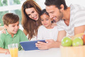 Family using a tablet pc — Stock Photo