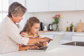 Grandmother and child looking at laptop — Stock Photo