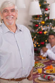 Happy grandfather standing at christmas — Stock Photo