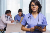 Nurse standing with tablet pc — Stock Photo