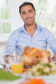 Man sitting at head of dinner table — Stock Photo