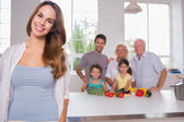 Mother in front of her family — Stock Photo