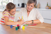 Little girl drawing with her grandmother focused — Stock Photo