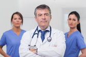 Doctor and his team of nurses — Stock Photo
